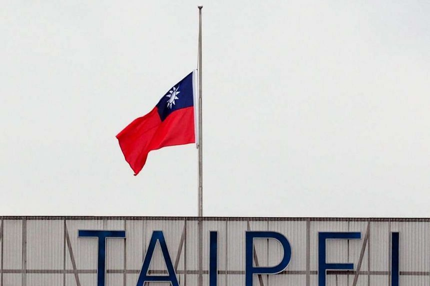 Taiwan's national flag flies at half mast at the Taipei Songshan Airport on Feb 15, 2016.
