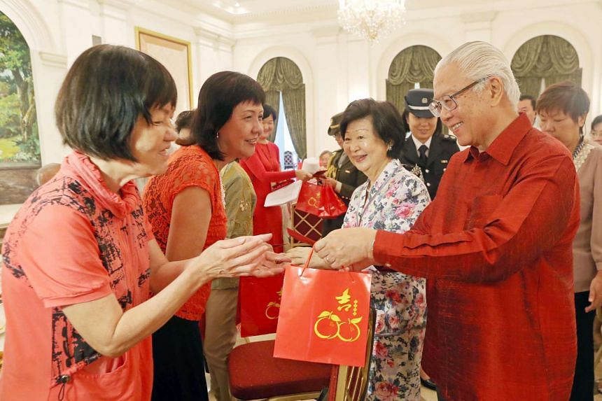 President Tony Tan Keng Yam and Mrs Mary Tan gives out red packets and mandarin oranges to elderly beneficiaries, volunteers and staff from Reach Community Services Society after hosting them to Lo Hei and lunch at the Istana on Feb 15, 2016 in cele