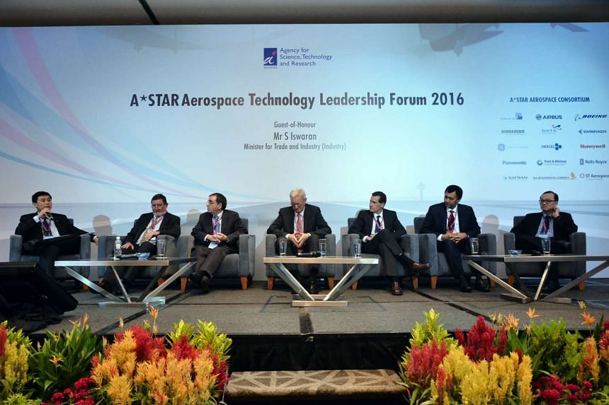 Associate Professor Tan Sze Wee, Executive Director, Science and Engineering Research Council (SERC), A*Star (far left) chairing a panel discussion during the A*StarAerospace Technology Leadership Forum 2016.