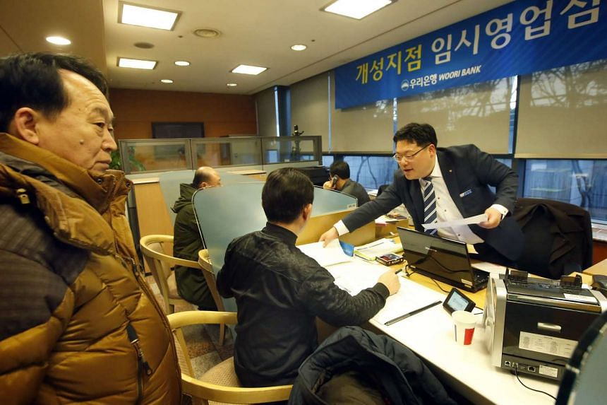 South Korean businessmen who run factories in the Kaesong industrial park receive consultations from Woori Bank in Seoul.