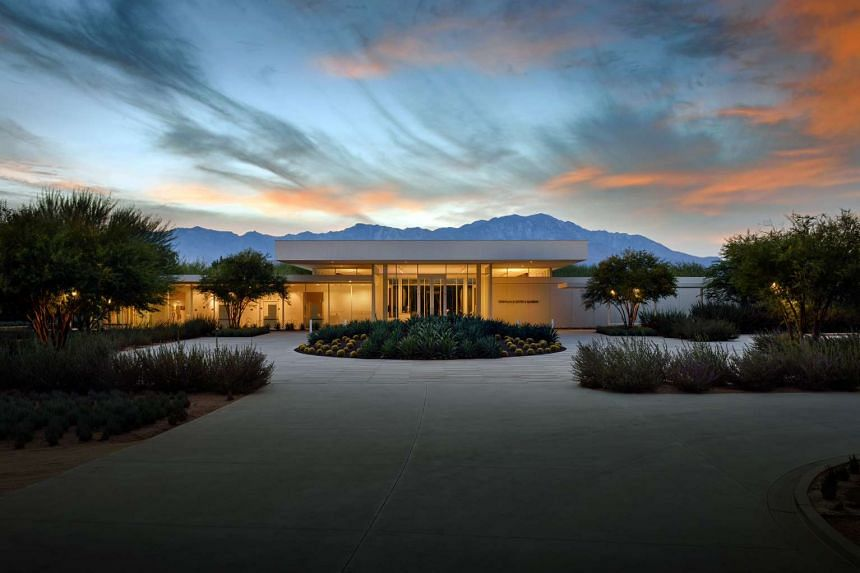 Front view of Sunnylands Centre at dusk. Mount San Jacinto looms in the background.
