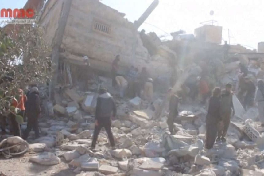 People gathering near a destroyed building said to be a Doctors without Borders (MSF) supported hospital, in Maaret al-Numan, Syria, on Feb 15, 2016.