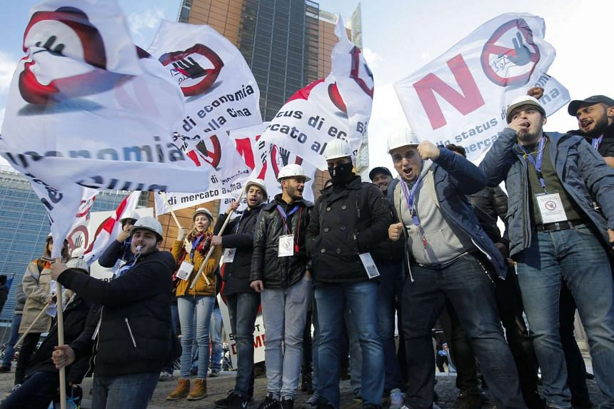 European steel workers protest against Chinese dumping prices in Brussels on Feb 15, 2016.