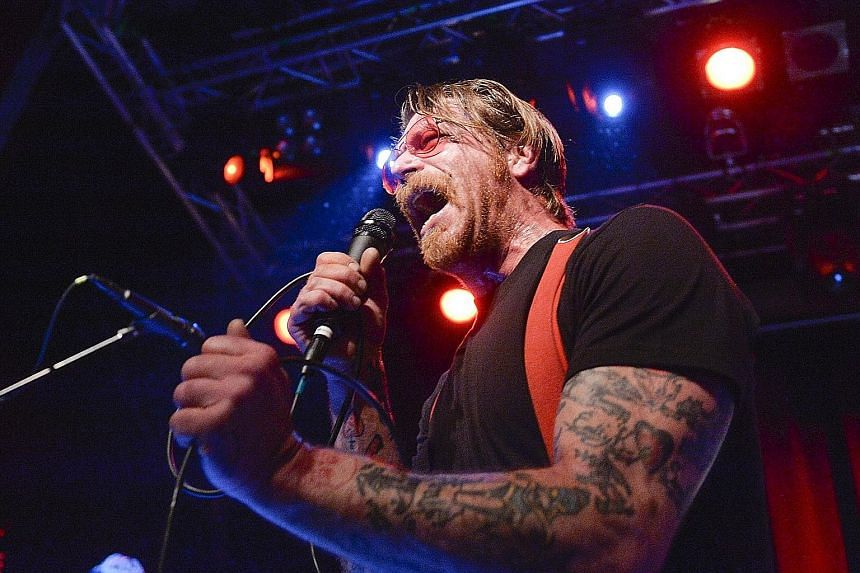 Eagles Of Death Metal performing on Nov 13 last year at Bataclan theatre in Paris, moments before gunmen stormed inside and killed 90 of the people in the audience. Frontman Jesse Hughes (above), who performed with the band in Stockholm last Saturday, sai