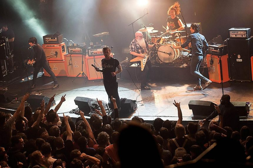 Eagles Of Death Metal (above) performing on Nov 13 last year at Bataclan theatre in Paris, moments before gunmen stormed inside and killed 90 of the people in the audience. Frontman Jesse Hughes, who performed with the band in Stockholm last Saturday, sai