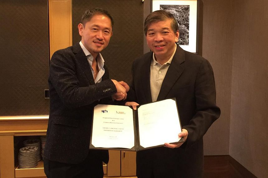 Mr Anthony Tan (left), Executive Vice President of the Chinese Media Group, Singapore Press Holdings, and Mr Teo Siong Seng, chairman of SBF.