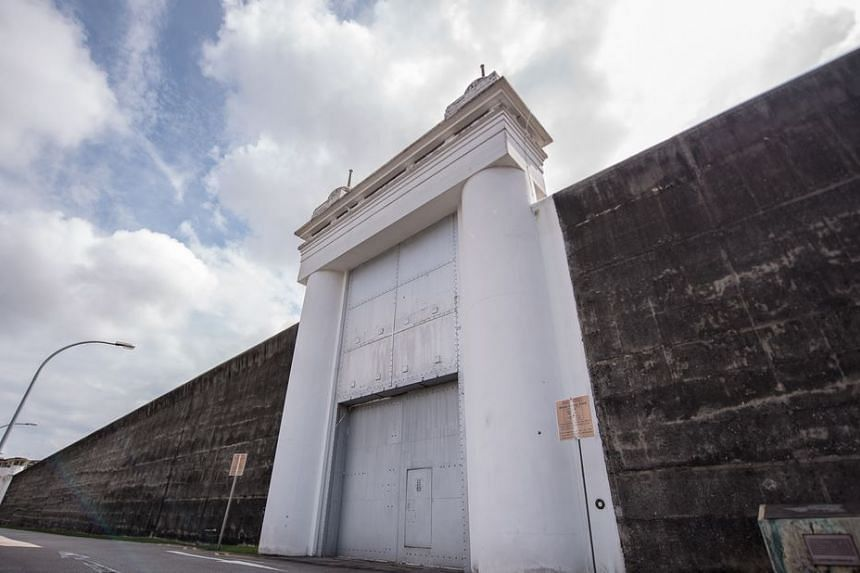 The entrance gate and high wall of Changi Prison.