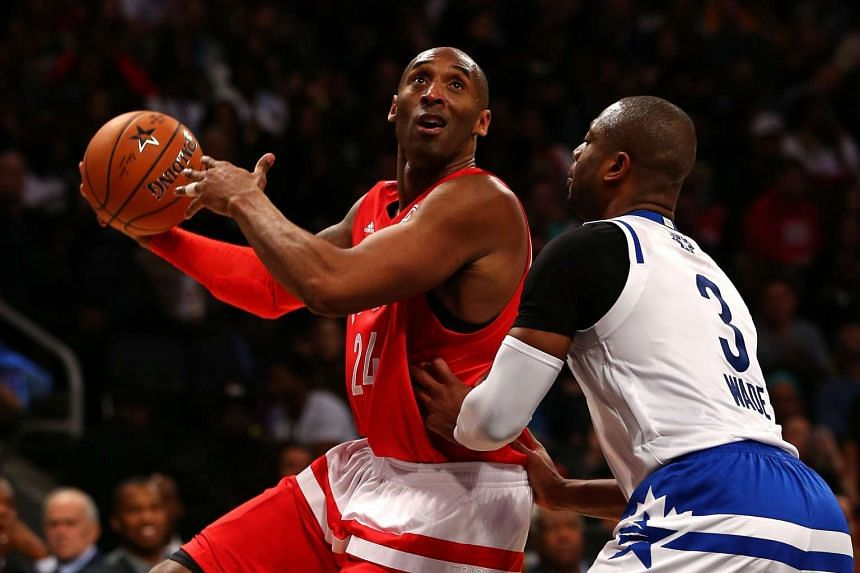 Kobe Bryant (left) of the Western Conference shoots in the second half against Dwyane Wade of the Eastern Conference during the NBA All-Star Game on Feb 14, 2016.