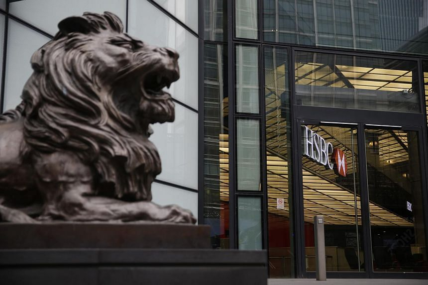 A sculpture of a lion sits outside the main entrance to the HSBC Holdings Plc headquarters in London.
