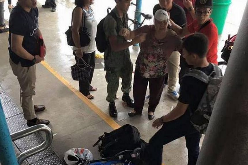 The elderly woman being tended to by the off-duty SAF personnel.