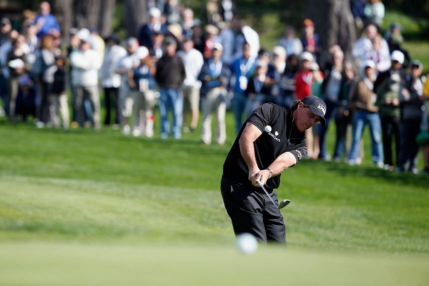 Phil Mickelson chips onto the third green during the final round of the AT&T Pebble Beach National Pro-Am.