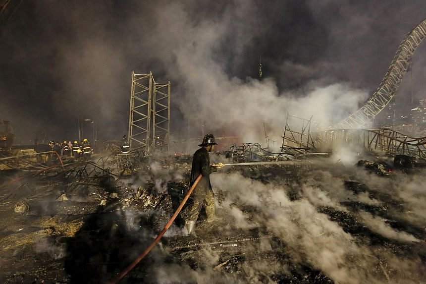 A firefighter tries to extinguish a fire at the venue of a cultural event during 'Make in India' week in Mumbai, India, on Feb 14, 2016.
