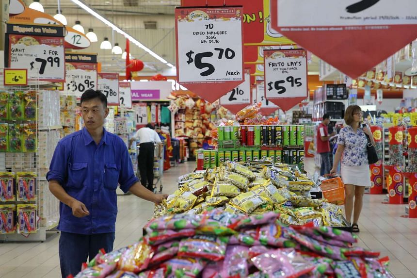 People shopping for groceries at Giant Tampines on Jan 13, 2016.