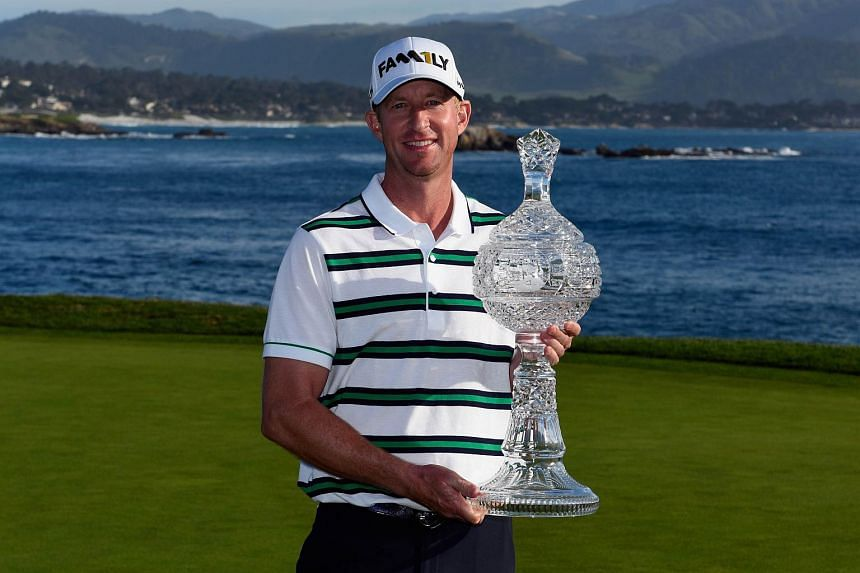 Vaughn Taylor poses with the trophy after winning the AT&T Pebble Beach National Pro-Am.