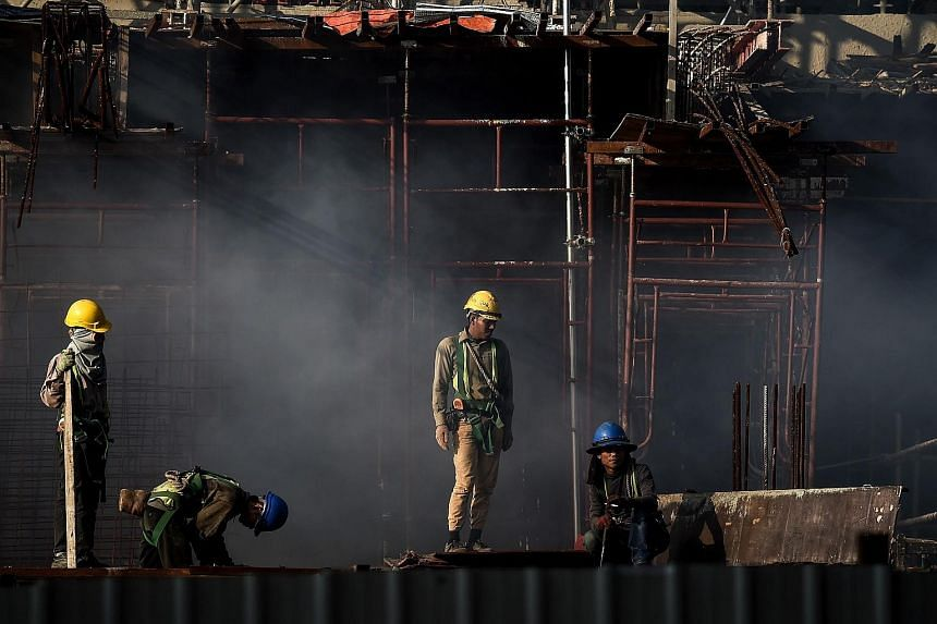 Men working at a construction site in Kuala Lumpur on Dec 30, 2015.