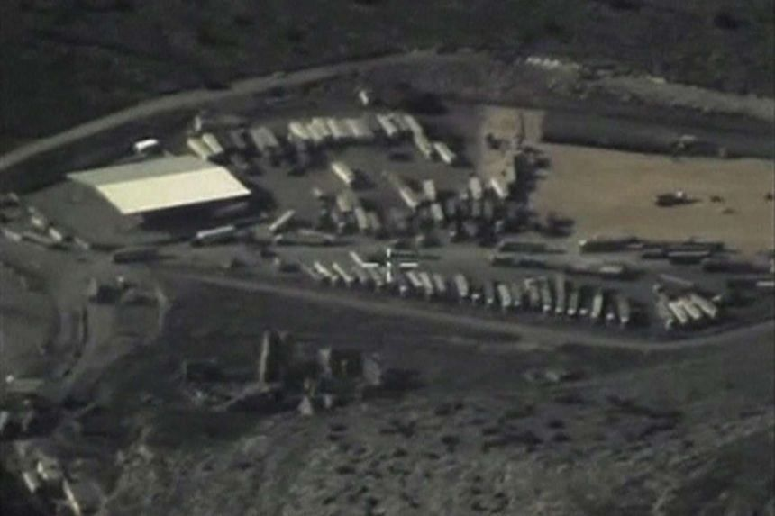 A frame grab taken from footage released by Russia's Defence Ministry on Dec 25, 2015, shows trucks crossing the Turkish-Syrian border, which, according to the ministry, carry oil.