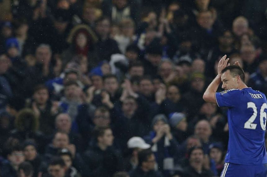 Chelsea's John Terry applauds fans as he walks off to be substituted after sustaining an injury on Feb 13, 2016.