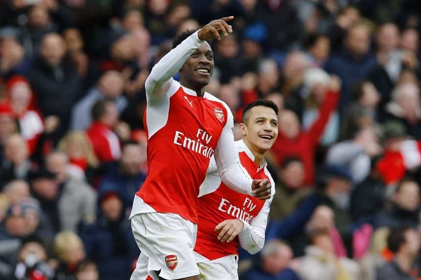 Arsenal defender Per Mertesacker said that Danny Welbeck's (left) return will boost the club's title hopes.