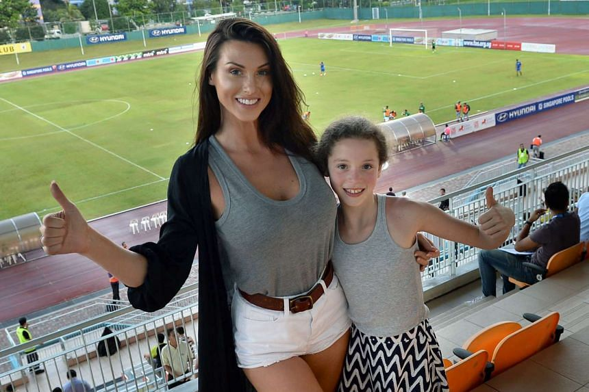 Jermaine Pennant's wife Alice Goodwin (left) with her daughter, Esme.