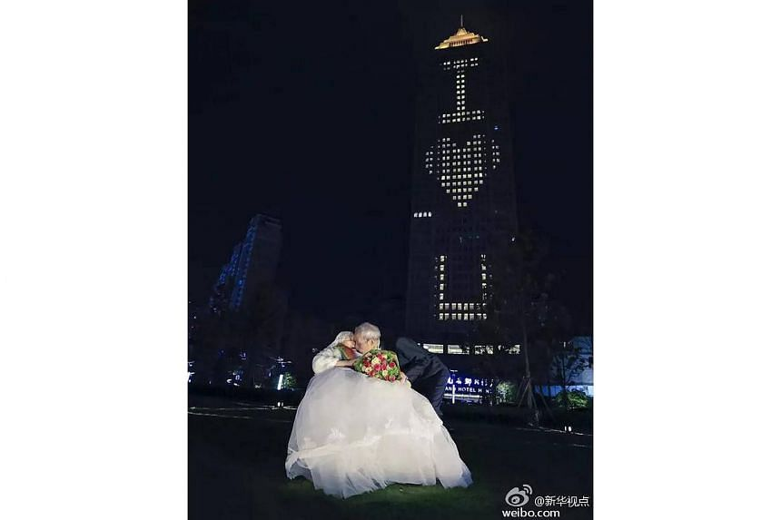 """Qiao Dewei used the lights of an entire building to spell out """"I (heart) U"""" to his wife on Valentine's Day."""