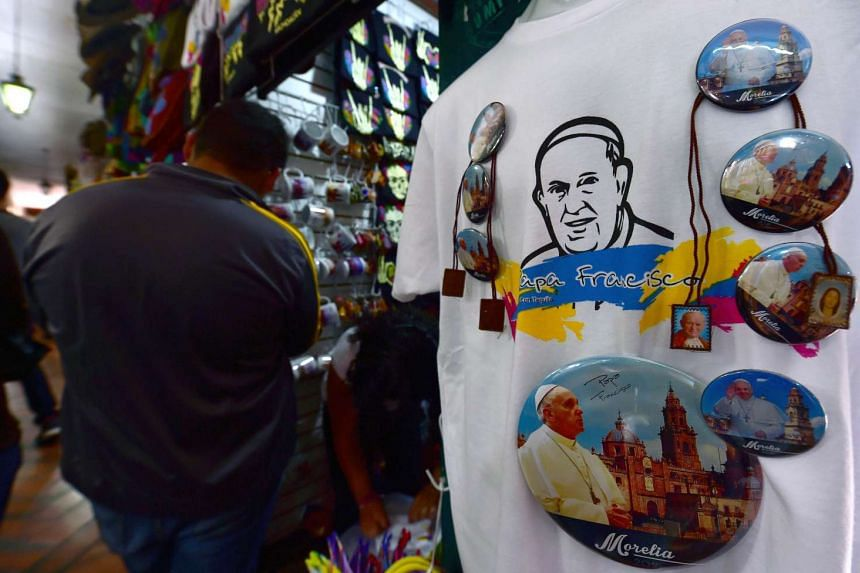 A T-shirt with an image of Pope Francis is sold at a market in Morelia, Michoacan State, Mexico, a day before the arrival of Pope Francis to the city, on Feb 15, 2016.