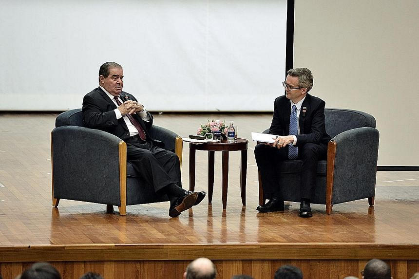 Justice Scalia (left) fielding questions during a dialogue at NUS Law, with Prof Chesterman.