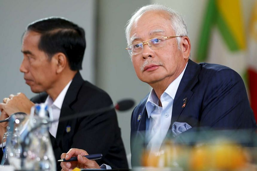 Malaysian PM Najib Razak listening to Mr Obama speak at the Asean summit in Sunnylands, California, on Feb 15.