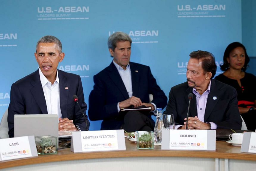 US President Barack Obama (left) making opening remarks at the Asean summit in Sunnylands, California, on Feb 15. With him is Sultan of Brunei Hassanal Bolkiah (right), US Secretary of State John Kerry (back, centre) and National Security Advisor Sus