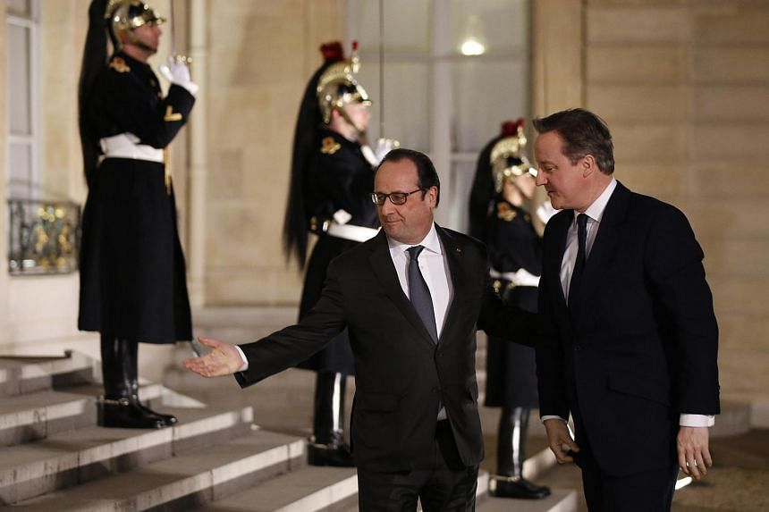 French President Francois Hollande (left) welcomes Britain's Prime Minister David Cameron at the Elysee Palace in Paris, on Feb 15, 2016.