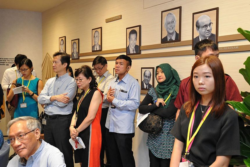 Photo wall showcasing past and current MAS chairmen and managing directors at The MAS Gallery on Feb 16, 2016.
