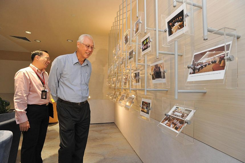 Mr Shenton Sng, (left) MAS officer, and ESM Goh, viewing compilation of photographs from various events from MAS at The MAS Gallery on Feb 16, 2016.