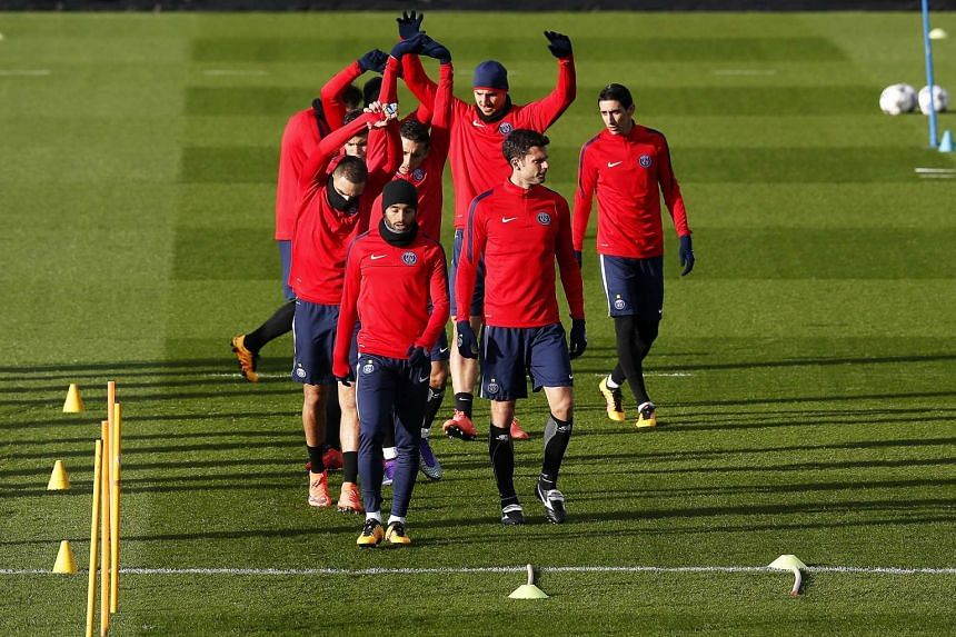 Players of Paris Saint-Germain warm up during a training session at the Ooredoo training centre in France, on Feb 15, 2016.