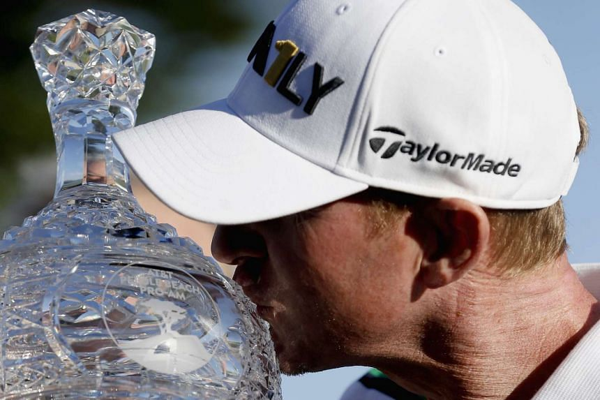 Vaughn Taylor poses with the trophy after winning the AT&T Pebble Beach National Pro-Am on Feb 14, 2016.