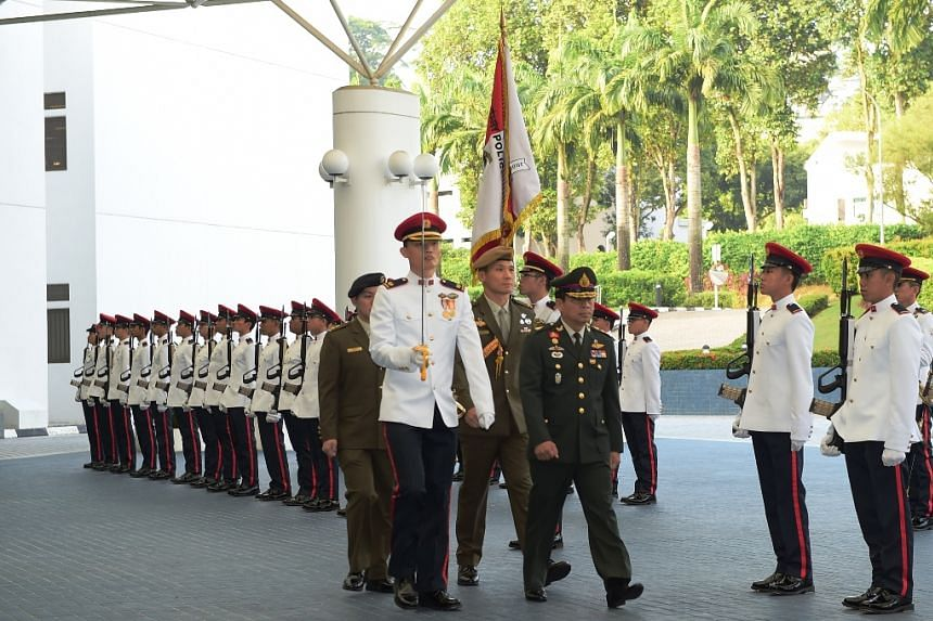 General Sommai inspecting a Guard of Honour at the Ministry of Defence on Feb 15, 2016.