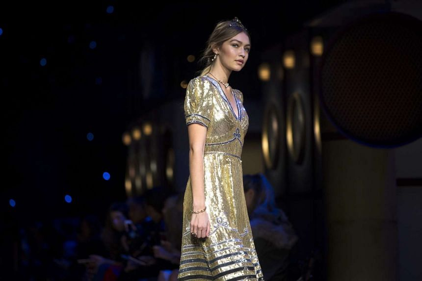 US model Gigi Hadid presents a creation from the Fall 2016 collection by US designer Tommy Hilfiger during the New York Fall Fashion Week on Monday.
