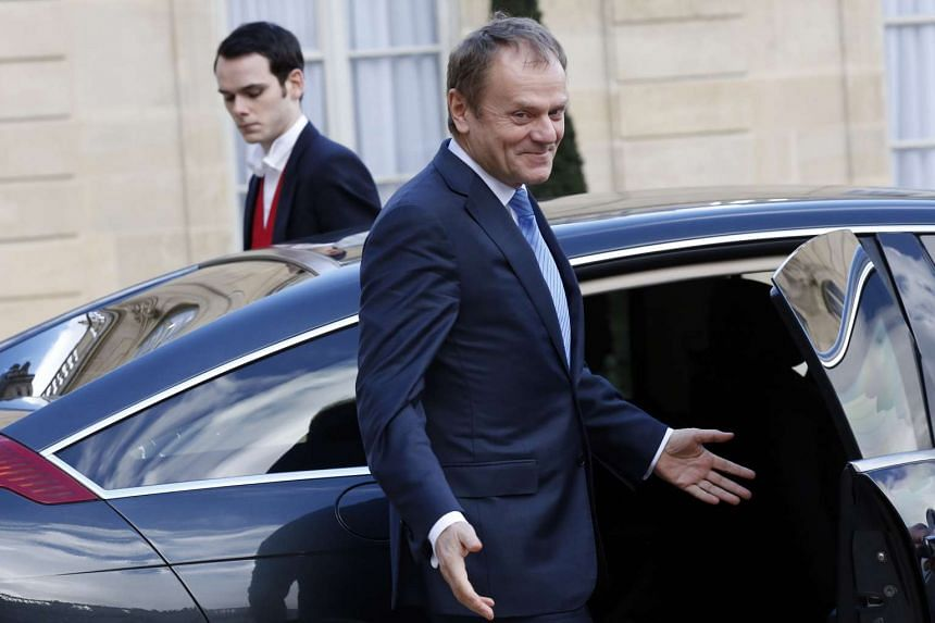 European Council President Donald Tusk enters his car as he leaves the Elysee Palace in Paris on Monday.