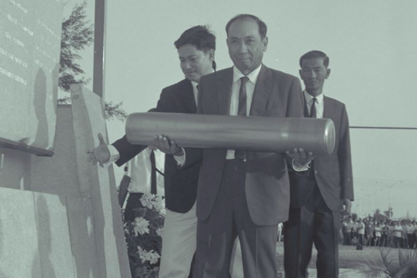The late Dr Goh Keng Swee, who was Finance Minister in 1970, with the time capsule at the laying of foundation stone for the $16.7 million National Stadium at Kallang. The capsule has not been found.