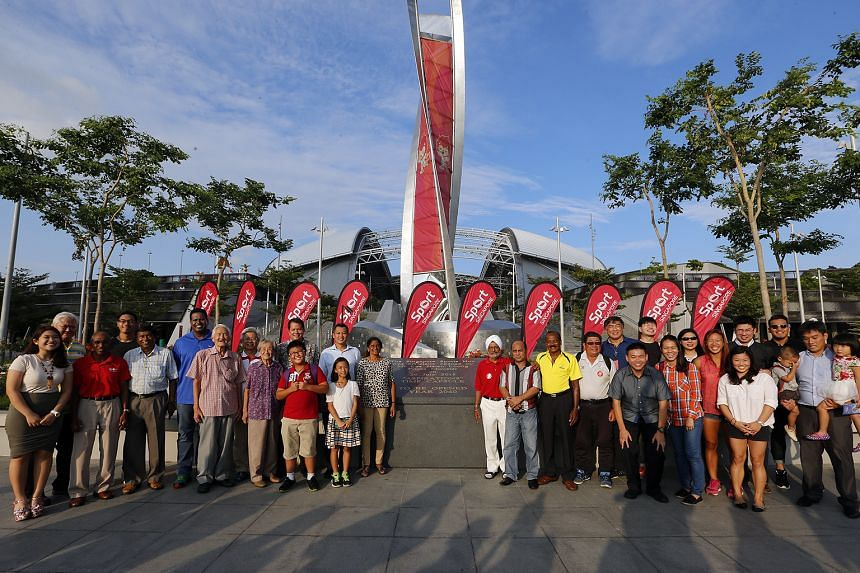 Current and former athletes join officials for the sealing of the Aspirations time capsule, which contains 50 items that symbolise Singapore's sporting aspirations. They include the spikes worn by sprinter Shanti Pereira, who blazed to victory in t