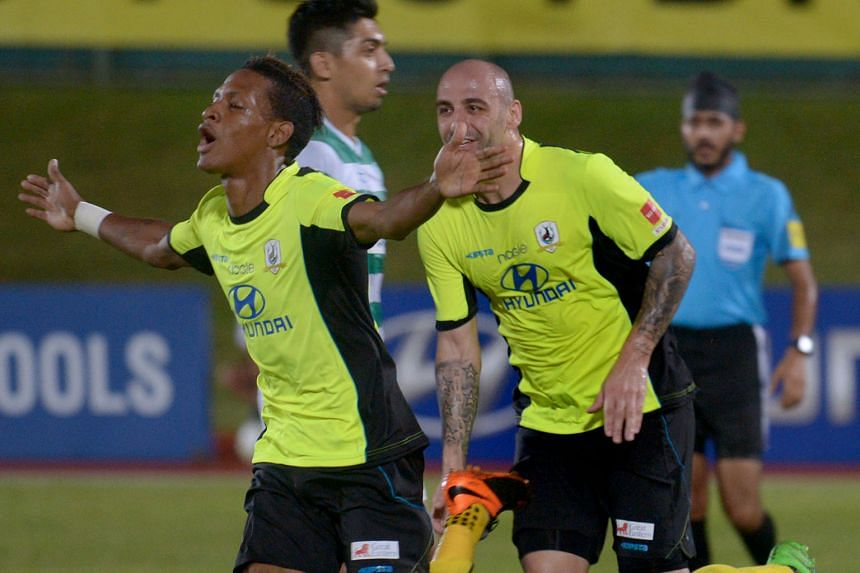 Tampines' Jordan Webb (left) celebrating his goal, which opened accounts at the Jurong West Stadium.