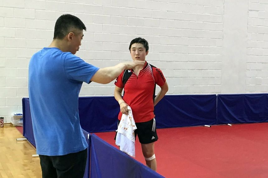 Chen giving Feng Tianwei directions at the Singapore Sports Hub. The men's and women's teams are preparing for the World Championships in Malaysia.
