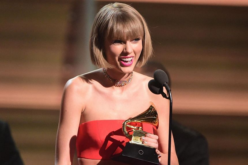 Singer Taylor Swift accepting the award for the Album of the Year onstage during the 58th Annual Grammy music Awards on Feb 15, 2016.