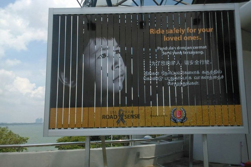 Billboards with rotating displays will be put up at land checkpoints to reach out to foreign motorcyclists entering Singapore.