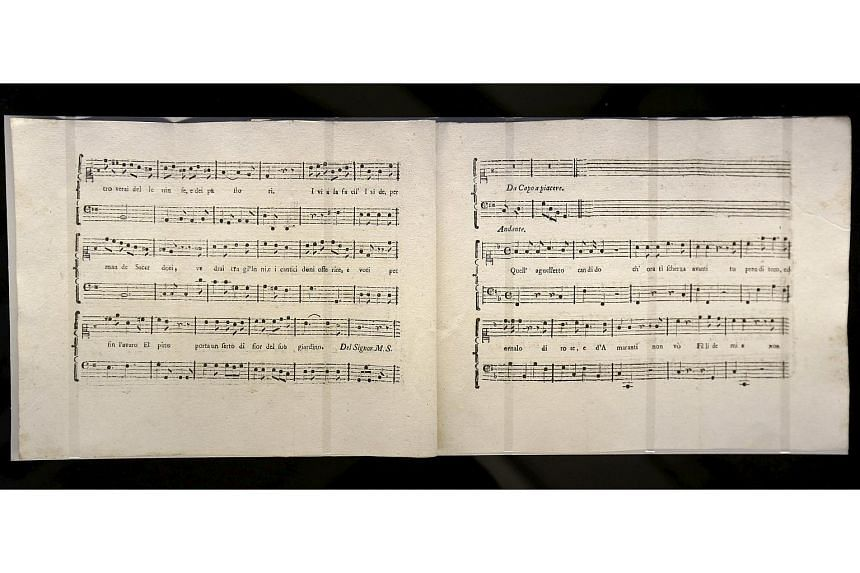 A detailed view of a music manuscript composed by Wolfgang Amadeus Mozart and Antonio Salieri.