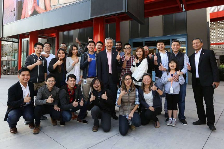 PM Lee Hsien Loong (centre) meeting Singaporeans working for Facebook in the US.