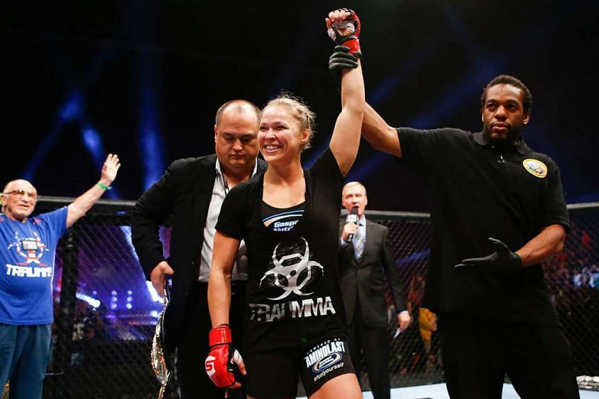 Mixed martial arts star Ronda Rousey celebrating after a bout in 2013.