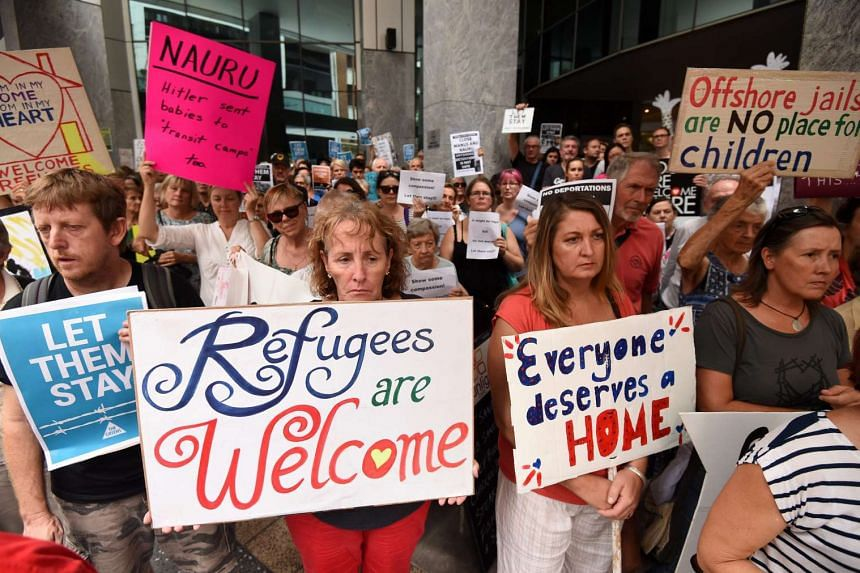Pro-refugee protesters rally outside the Immigration Office in Brisbane, Australia.