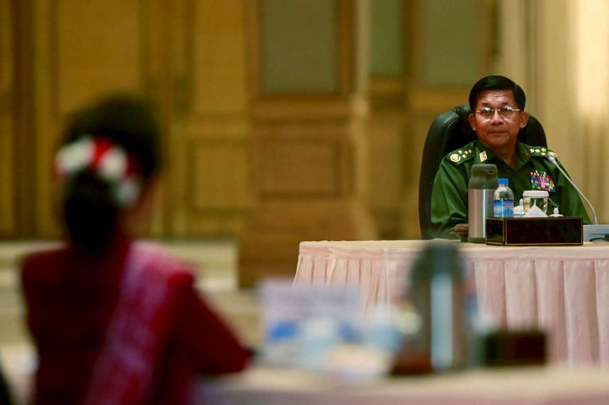 Myanmar military Commander-in-chief Senior General Min Aung Hlaing (background) is in talks with Aung San Suu Kyi for the third time since her party won the elections.