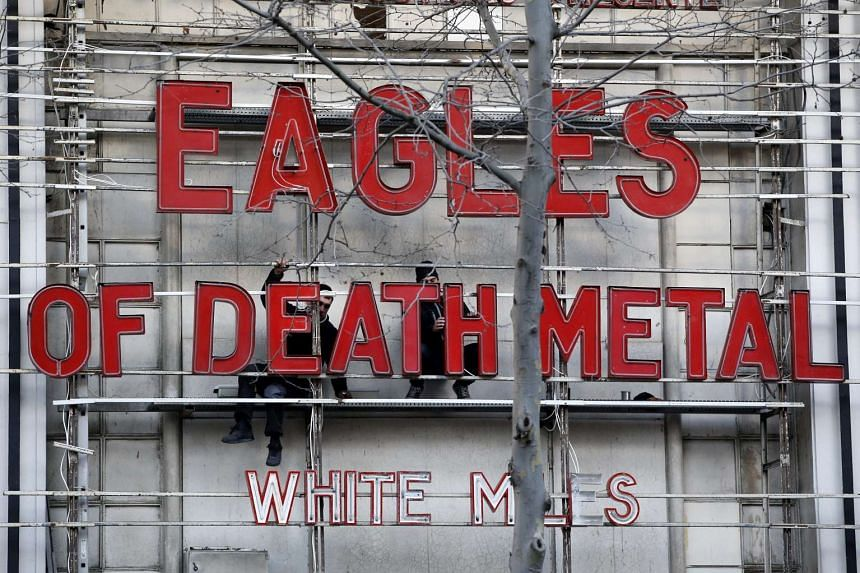 The name of the Eagles of Death Metal is displayed in giant red letters on the facade of the Olympia music venue in Paris, France, on Feb 16, 2016.