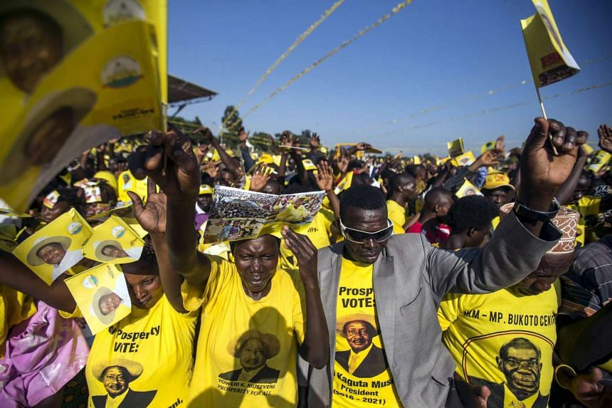Supporters of Uganda's President Yoweri Museveni attend his last campaign rally at Kololo grounds in Kampala on Feb 16, 2016.
