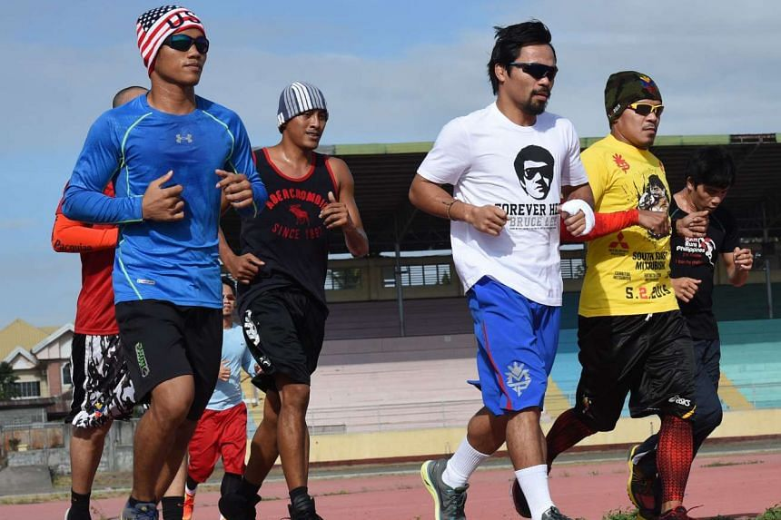 Philippine boxing icon Manny Pacquiao (in white) jogging with fellow boxers in Mindanao.